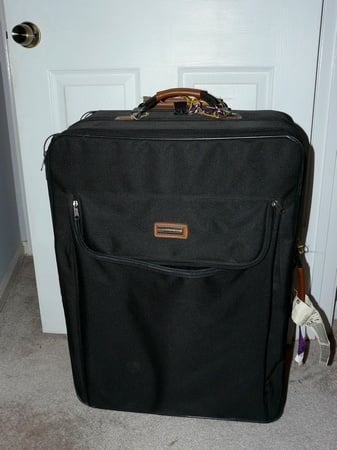 how to travel carry-on only - big suitcase that is clearly not small enough