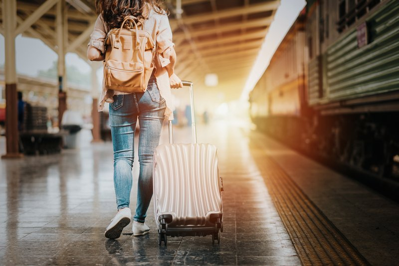 solo travel woman with suitcase