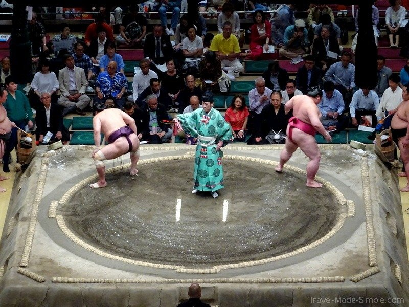 sumo tournament Tokyo Japan intimidation rituals